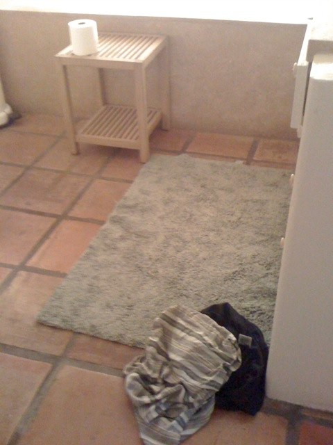Clothes on the bathroom floor